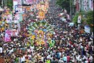 Devotees participate in a Ganesh Visarjan procession