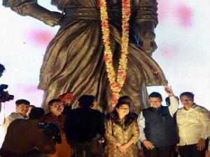 Chief Minister of Maharashtra Devendra Fadnavis waves after paying tributes to Chatrapati Shivaji Maharaj on the eve of Maharashtra Day celebrations in Mumbai 02