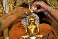 Jain devotees perform rituals to the idol of lord Mahavir on the occasion of 'Mahavir Jayanti'