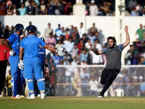 A fan runs to greet India A skipper MS Dhoni during a practice match against England at Brabourne stadium