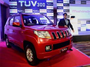 Senior Vice President Sales, Veejay Nakra pose with the newly launched TUV300