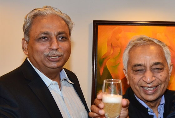 CP Gurnani, MD, Tech Mahindra (Left) and Vineet Nayyar, Executive Vice-Chairman of the company celebrate with colleagues the merger of Mahindra Satyam with Tech Mahindra, in New Delhi