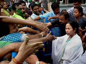 West Bengal CM Mamata Banerjee shaking hands with supporters after her party's thumping win in West Bengal Assembly elections