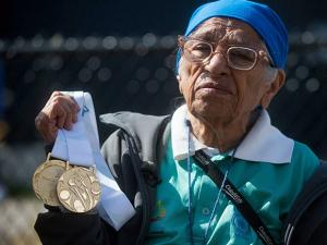 Man Kaur of India, holds the gold medals