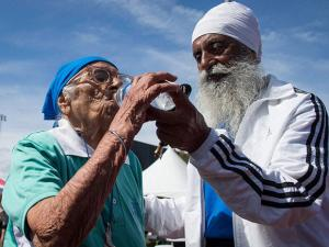 Man Kaur of India, is helped by her son Gurdev Singh