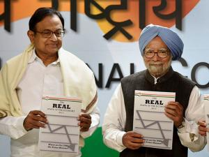 Former Prime Minister Manmohan Singh and former Finance Minister P Chidambaram release 'The REAL State of Economy Report- 2017' at AICC