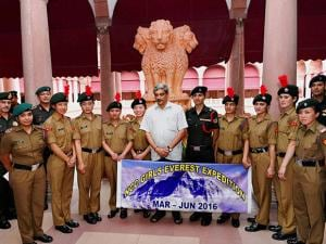 Defence Minister Manohar Parrikar pose for a group photo with NCC cadets who successful scale Mt Everest during a meeting in South Block, New Delhi