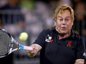Elton John hits the ball during a World Team Tennis exhibition