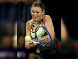 Maria Sharapova hits the ball during a World Team Tennis exhibition