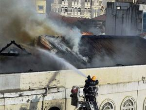 Fire men dousing a major fire at building on the Colaba Causeway in south Mumbai