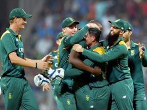 South African players celebrate Indian batsman Virat Kohali's wicket