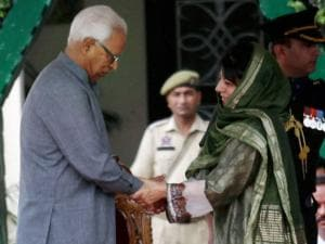 Jammu and Kashmir Governor NN Vohra administers oath to Chief Minister Mehbooba Mufti, at Raj Bhawan in Jammu.
