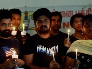 Members of LGBT (lesbian, gay, bisexual, and transgender) community observe a candlelight vigil to pay tribute to victims of a massacre at a gay club in the US city of Orlando, in Chennai