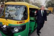 Michael R Bloomberg in an auto rickshaw as he arrives for Re- Invest meet in New Delhi