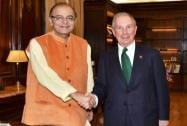 Union Finance Minister Arun Jaitley shakes hands with ichael R Bloomberg