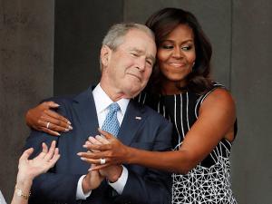 Michelle Obama, hugs former President George W. Bush