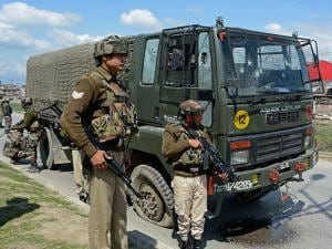 Security personnel take positions during a search operation after militants attacked an army vehicle
