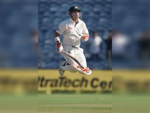 Australian player David Warner during  the first test match played against India in Pune