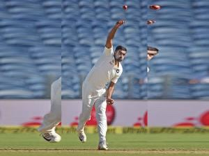 Indian bowler R Ashwin bowls on the opening day of  the first test match played against Australia in Pune
