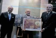 Modi is presented a photograh during a visit to the CNES