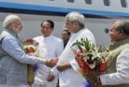 Prime Minister Narendra Modi is received by Governor of Odisha, S.C. Jamir and the Chief Minister of Odisha, Naveen Patnaik