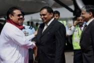 Mahinda Rajapaksa being welcomed by Indian officials