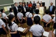 Prime Minister Narendra Modi interacts with students during a visit to Taimei Elementary school