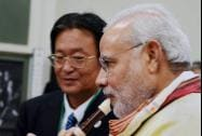 Prime Minister Narendra Modi tries a Japanese flute during a visit to Taimei Elementary school