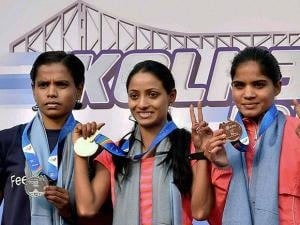 Women's Elite 25K winner Monika Athare flanked by Jyoti Gawte and Monika Raut poses for a photograph during the prize distribution ceremony in Kolkata