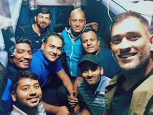 Jharkhand cricket team captain MS Dhoni with his team-mates while travelling in a train