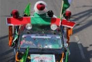 Muslims in a vehicle particpate in Muharram procession in Ranchi