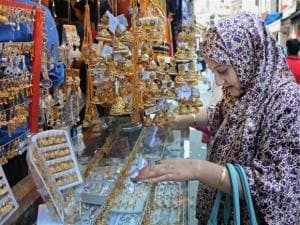 A Muslim women busy in shopping at a market