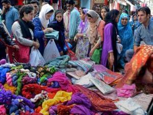Muslim women purchasing clothes in Srinagar