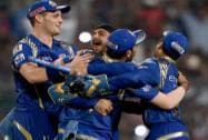 Mumbai Indian captain Rohit Sharma, Harbhajan Singh and Parthiv Patel celebrate after beating Chennai Super Kings