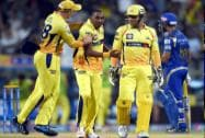 Chennai Super Kings' Players celebrate the wicket of  Mumbai Indians'  Parthiv Patel