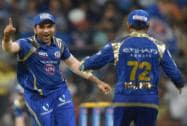 Mumbai Indians' player Rohit Sharma and  Parthiv Patel celebrate the wicket of CSK's Dwayne Bravo