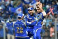 Mumbai Indians players celebrate the wicket of Delhi Daredevils batsman JP Duminy