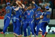 Mumbai Indians players Mitchell McClenaghan, Harbhajan Singh celebrate