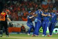 Mumbai Indians players Mitchell McClenaghan, Harbhajan Singh celebrate