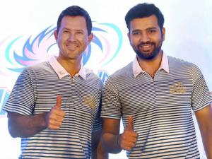 Mumbai Indians' coach Ricky Ponting and captain Rohit Sharma striking a pose after addressing a press conference in Mumbai.