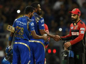 Mumbai Indians players Hardik Pandya and Kieron Pollard being greeted by Rohit Sharma of Royal Challengers Bangalore after the victory during the IPL match in Mumbai