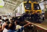 A Mumbai local train derails from the platform after the driver lost control at Churchgate