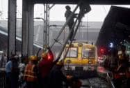 Railway workers repair the Central line