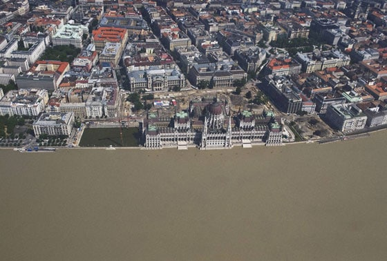 Aerial view of the rising water of the flooding River Danube approaching the Parliament building, centre, in Budapest, Hungary