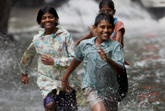 Children enjoying the pre-monsoon shower in Mumbai on Monday morning
