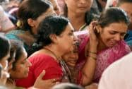 Wailing family members during the funeral of Parag Sawant