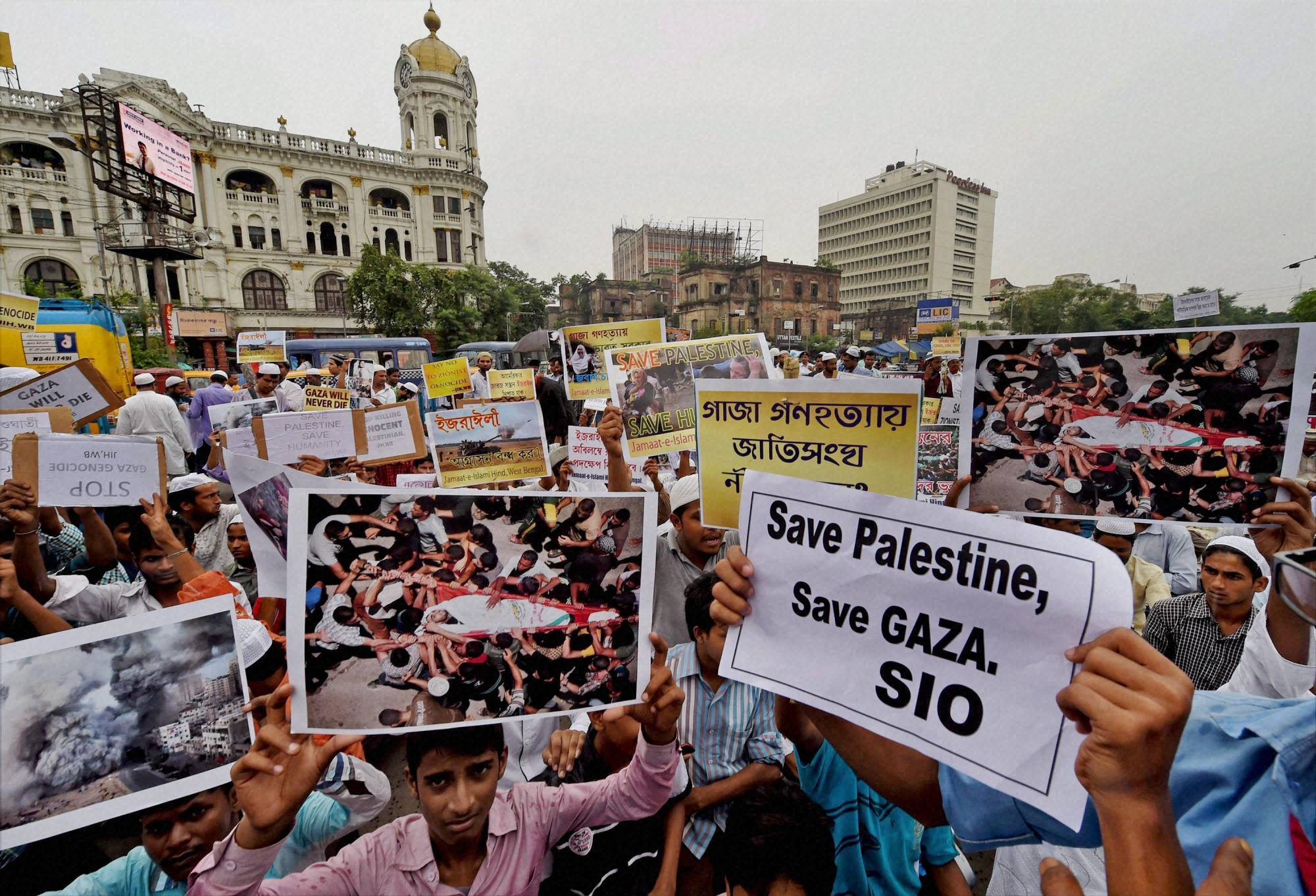 Muslims, display posters,protest, against Israel's, military, operation, Gaza, kolkata
