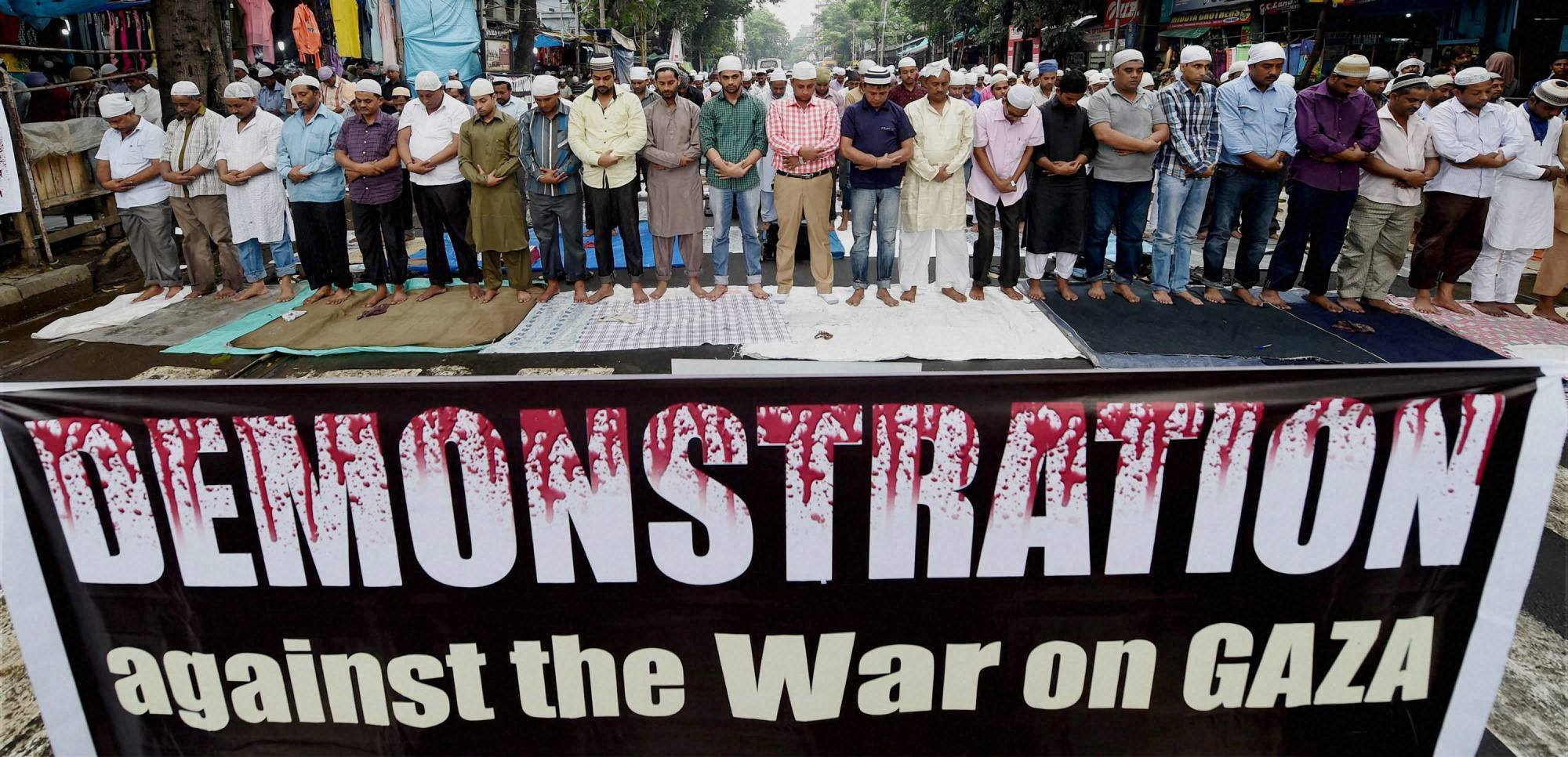 Muslims, put up, banner, against Israel's attack, Gaza,  prayers, Tipu Sultan Mosque, Kolkata, holy month Ramadan
