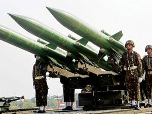 Myanmar's military officers atop trucks loaded with missiles during a parade to commemorate the Myanmar's 72nd Armed Forces Day in Naypyitaw, Myanmar