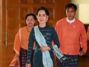 National League for Democracy party (NLD) leader Aung San Suu Kyi, center, arrives in Manama's parliament in Naypyitaw, Myanmar
